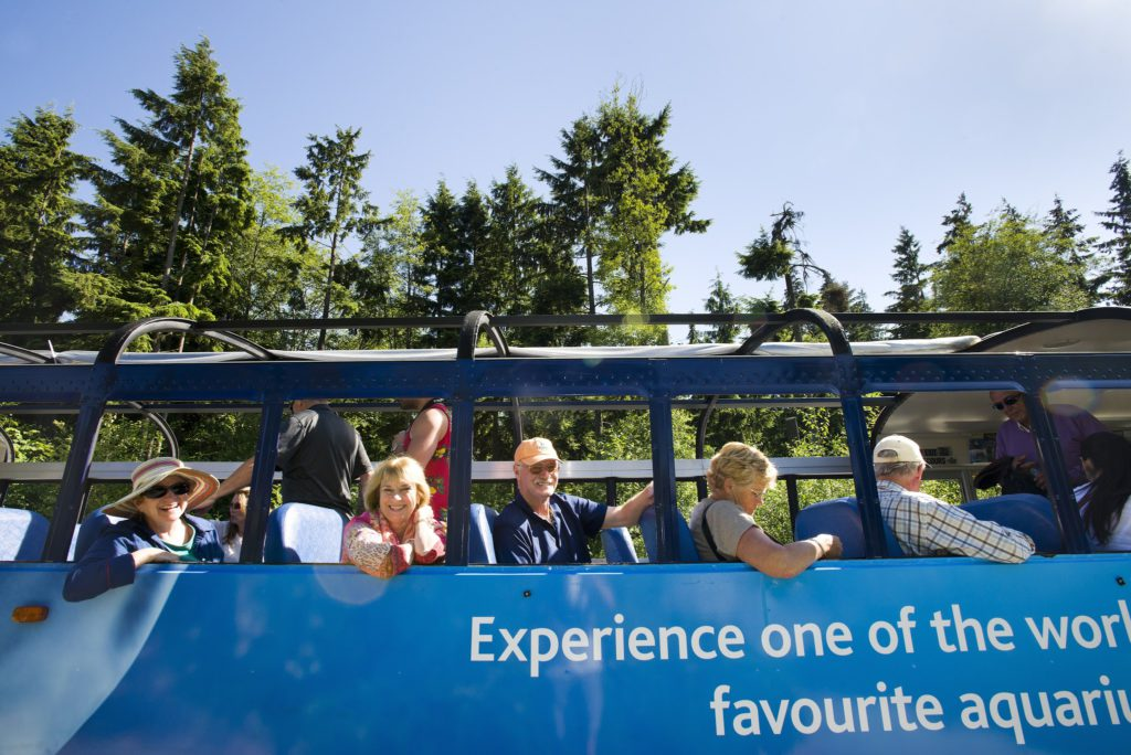 Tourists Smiling on the Westcoast Sightseeing Hop-On, Hop-Off Tour Bus in Vancouver, British Columbia