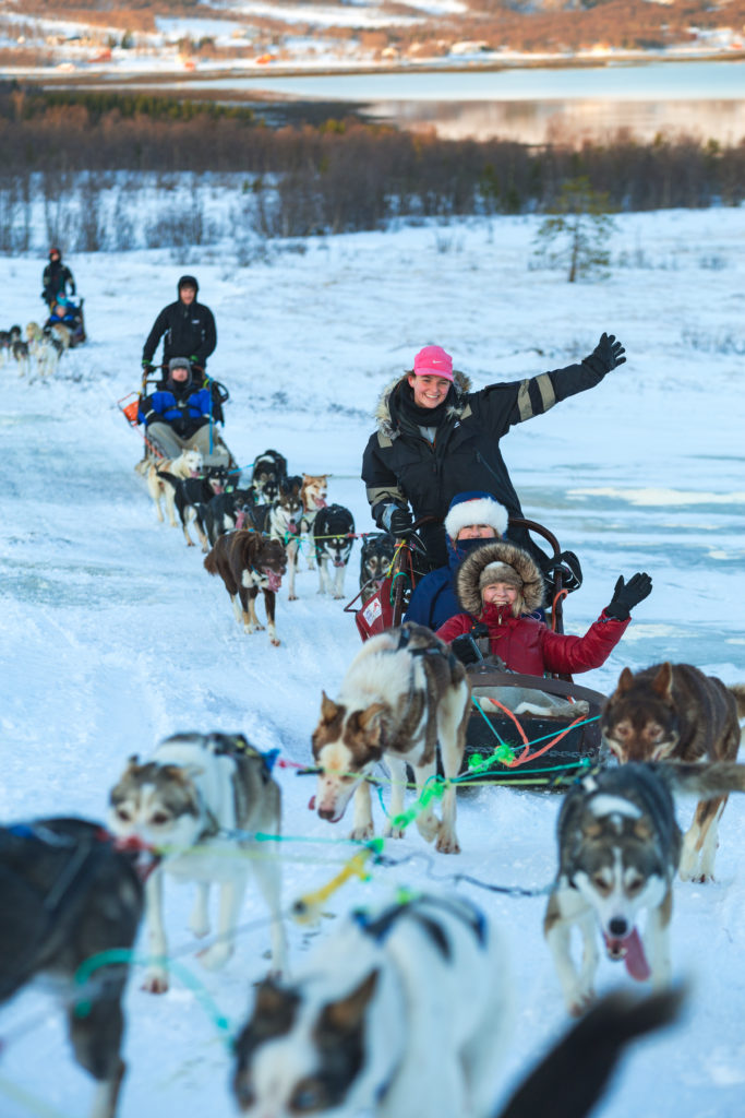 Tourists having fun on a dog sled ride at the Tromso Wilderness Centre